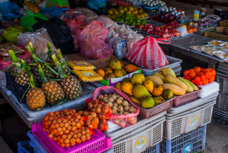 The traditional Asian market with food. Sale a variety of fruits lying on the counter Malaysia