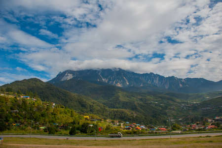 Mount Kinabalu view, villages at the foothill of the mountain. Sabah, Borneo island, Malaysia Stok Fotoğraf