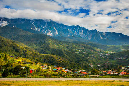 Mount Kinabalu view, villages at the foothill of the mountain. Sabah, Borneo island, Malaysia Stock Photo