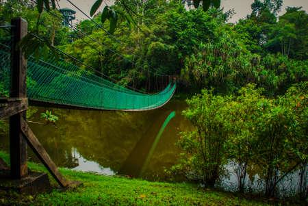 The suspension bridge over the lake in the summer, Borneo, Sabah Malaysia Stock Photo