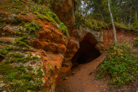 Beautiful Orange cave in Russia. The entrance to the cave. Leningrad oblast.