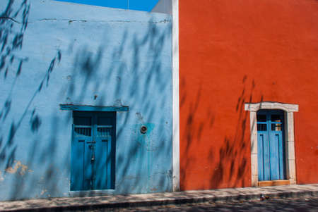 Vintage and old wooden door. Colorful buildings on Mexican street. The centre of Valladolid in Mexico Yucatan. Stock Photo