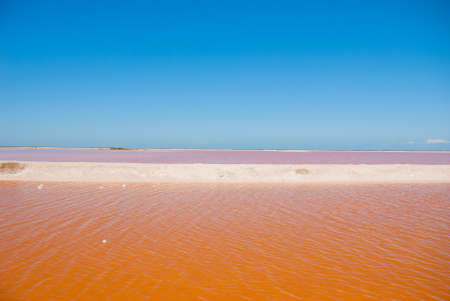 Striking red pool used in the production of salt near Rio Lagartos, Mexico, Yucatan.