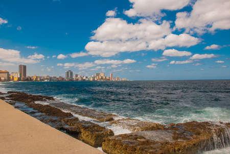 View from the Malecon promenade to the city. Cuba. Havana Banco de Imagens