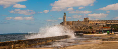 Stormy waves hitting the seawall near to The Castillo Del Morro lighthouse in Havana. The old fortress Cuba.