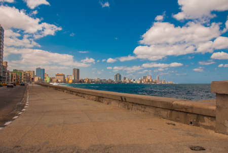 View from the Malecon promenade to the city. Cuba. Havana Stock Photo
