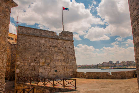 The flag of Cuba is developing in the wind. Castillo Del Morro. Havana. The old fortress Cuba