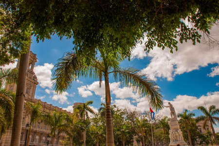 Statue of Jose Martion of the background of trees and buildings. Cuba. Havana. Stock Photo