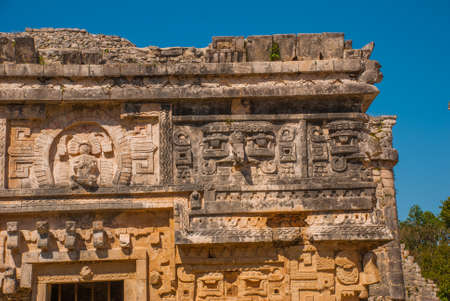 Ancient Mayan drawings on stone. The texture of the stone. Fragment of an old building. Chichen-Itza, Mexico. Yucatan.