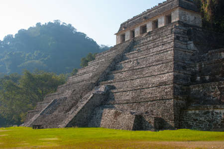 The scenery of the mountains and the ancient Maya pyramid. The famous archaeological complex. Mayan ruins in Palenque, Chiapas, Mexico Stock Photo