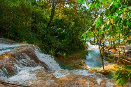 Beautiful landscape with waterfall Agua Azul, Chiapas, Palenque, Mexico. Huge stones on which water flows Stock Photo