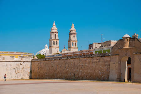 San Francisco de Campeche, Mexico: The sea gate or Bastion of the Puerta del Mar. Cathedral in Campeche on a blue sky background.