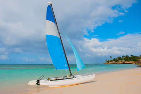 Holguin, Guardalavaca Beach, Cuba: Sailing boat stands on the beach