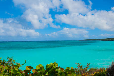 Playa Esmeralda, Holguin, Cuba: Beautiful landscape with the Caribbean sea turquoise and blue sky with clouds.