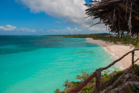 Playa Esmeralda in Holguin, Cuba. The view from the top of the beach. Beautiful Caribbean sea turquoise and blue sky with clouds.