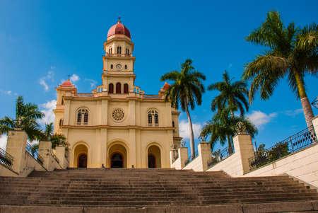 Basilica Virgen de la Caridad close up. Roman Catholic minor Catholic cathedral dedicated to the Blessed Virgin Mary against the blue sky. El Cobre, Santiago de Cuba, Cuba