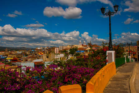 Santiago de Cuba, Cuba: Street lamp. Top view of the city, view of the house and the Catholic Cathedral Stock Photo