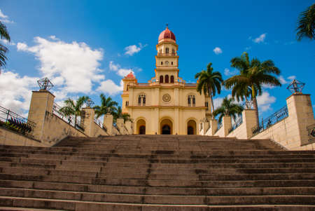 Stairs leading to the temple Basilica Virgen de la Caridad. Roman Catholic minor Catholic cathedral dedicated to the Blessed Virgin Mary. El Cobre, Santiago de Cuba, Cuba