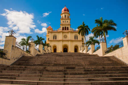 Stairs leading to the temple Basilica Virgen de la Caridad against the blue sky. Roman Catholic minor Catholic cathedral dedicated to the Blessed Virgin Mary. El Cobre, Santiago de Cuba, Cuba Stock Photo