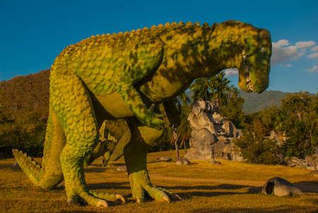 Statue of a giant green dinosaur. Prehistoric animal models, sculptures in the valley Of the national Park in Baconao, Santiago de Cuba, Cuba.