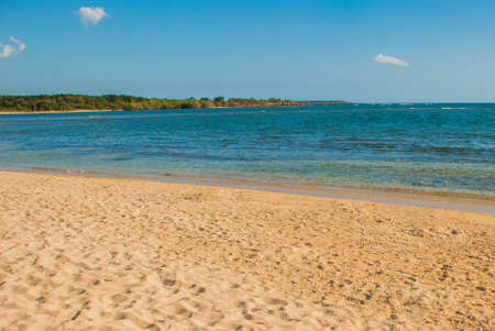 Paradise landscape with yellow sand and blue Caribbean sea. Cienfuegos, Cuba, Rancho Luna Beach