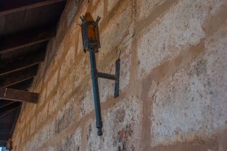 The torch on the wall. Fortification of Castillo de Jagua castle, Cuba, Cienfuegos. The old fortress served as protection from pirates.