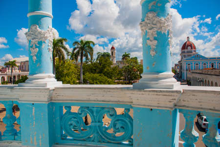 CIENFUEGOS, CUBA: View of the building Municipality through the blue columns of the Palace, Palacio Ferrer.