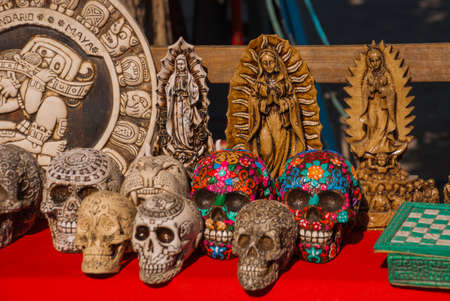Colored skulls. Mexican crafts for tourists on the market. Mexico City