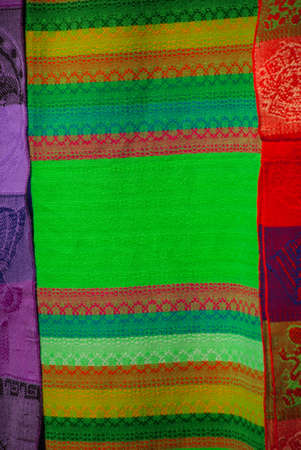 Souvenirs on the market. Multi-colored clothes. National clothes of Mexico. Multicolored textiles being representative for the latin america culture. Shawl of bright colorful