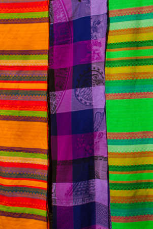 Souvenirs on the market. Multi-colored clothes. National clothes of Mexico. Multicolored textiles being representative for the latin america culture. Shawl of bright colorful. Stock Photo