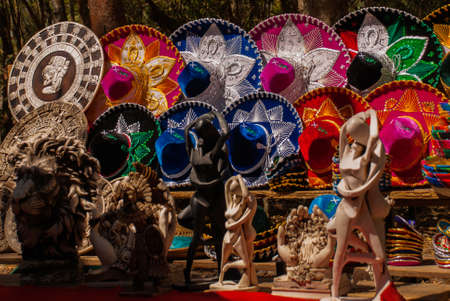 Traditional colorful Mexican sombrero hats, Souvenirs are sold to tourists on the market. Mexico. Stock Photo