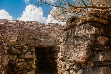 Tulum, Yucatan, Mexico: The entrance to the temple. Archeological ruins built by the Mayas. Ancient city