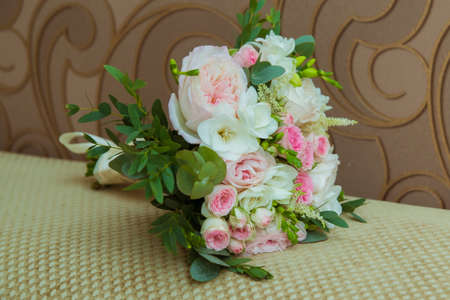 Beautiful brides bouquet of pink roses and white flowers on the wedding day. Фото со стока