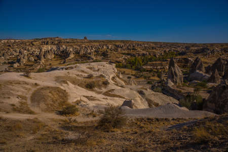 Cappadocia, Goreme, Anatolia, Turkey. Urgup panorama seen from the observation deck. Beautiful landscape with mountains and unusual rock formations.