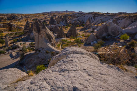 Beautiful landscape with mountains and unusual rock formations. Top view from the observation deck Goreme. Cappadocia, Goreme, Anatolia, Turkey.