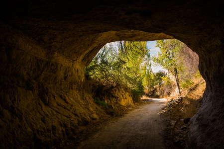 Scenic natural rock tunnel on the mountain trail Valley, Cappadocia, Goreme region, Anatolia, Turkey