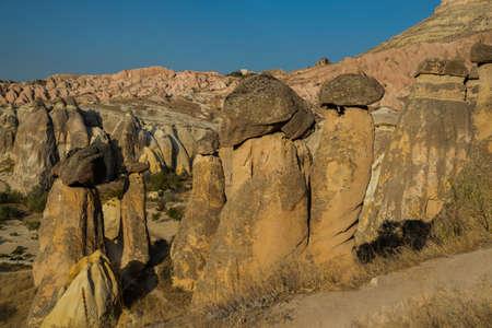 Fireplaces fairies, Peri bacalar. Cave house of Fairy Chimneys rocks mushroom in Pasabag, Monks Valley, Cappadocia, Anatolia, Turkey.