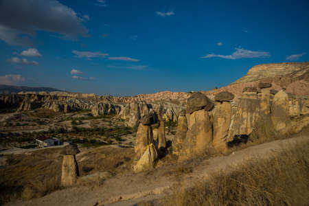 Fireplaces fairies, Peri bacalar. Cave house of Fairy Chimneys rocks mushroom in Pasabag, Monks Valley, Cappadocia, Anatolia, Turkey.