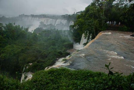 Argentina, Iguazu Falls: Dramatic view of Iguazu waterfalls in Argentina with stormy clouds.