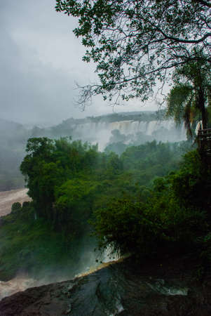Argentina, Iguazu Falls: Dramatic view of Iguazu waterfalls in Argentina with stormy clouds.