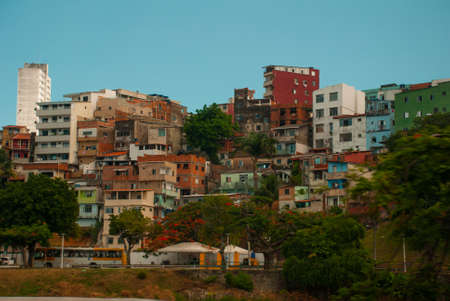 SALVADOR, BAHIA, BRAZIL: Street with modern houses in the city Sao Salvador da Bahia de Todos os Santos. South America. The poor quarter, the so-called favelas.