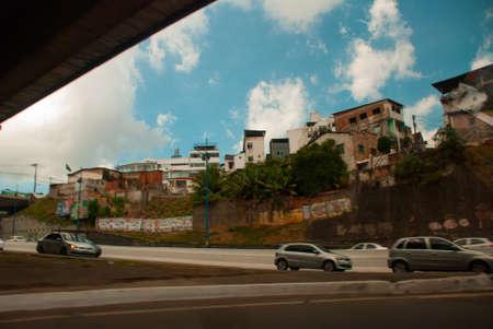 SALVADOR, BAHIA, BRAZIL: Street with modern houses in the city Sao Salvador da Bahia de Todos os Santos. South America. The poor quarter, the so-called favelas.
