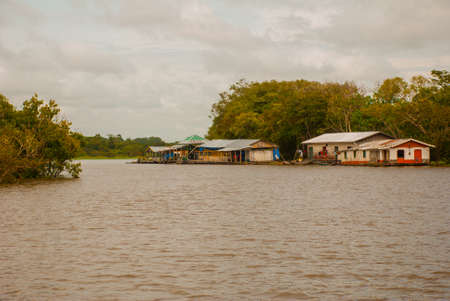 Amazon river, Manaus, Amazonas, Brazil, South America: Wooden local huts, houses on the Amazon river in Brazil. Stock Photo