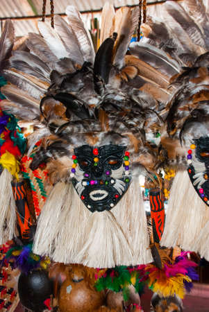 Mask. Souvenirs in the Amazon rainforest made from local nuts and animals near Iquitos. Market for tourists on the Amazon river. Manaus, Amazonas, Brazil Stock Photo