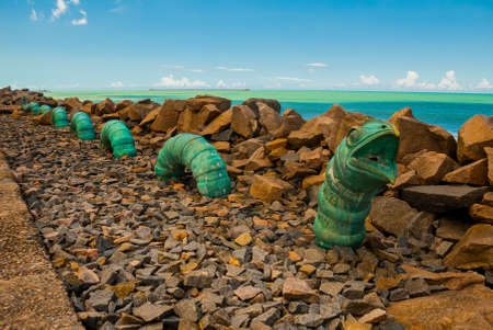 Recife, Pernambuco, Brazil, South America: The sculpture park in Recife. Monument to a huge snake, like a worm.