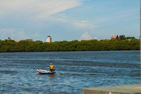 Region surrounding the Capibaribe River in the old neighborhood of Santo Antonio, in downtown Recife, Pernambuco, Brazil. The Mauricio de Nassau Bridge is visible in the background. Foto de archivo