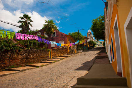 Olinda, Pernambuco, Brazil, South America: The historic streets of Olinda in Pernambuco, Brazil with its cobblestones and buildings dated from the 17th century when Brazil was a Portuguese colony.