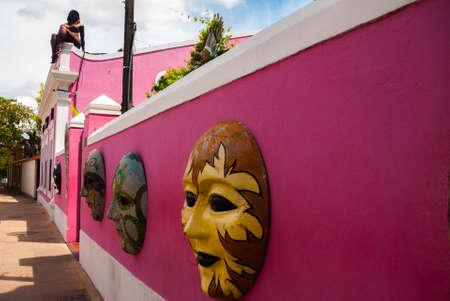 Olinda, Pernanbuco, Brazil, South America: Papangu masks, a traditional local carnival costume, exhibited in the street wall of an Olinda art shop