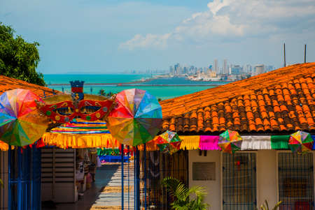 Olinda, Brazil: A view of the Handicrafts Market in Olindas historic center, cityscape of Recife in the background. South America