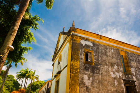 The colonial buildings of the historic Brazilian city of Olinda in Pernambuco, Brazil with its cobblestone streets and catholic church at sunrise. South America